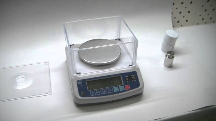 проведение юстировки весов